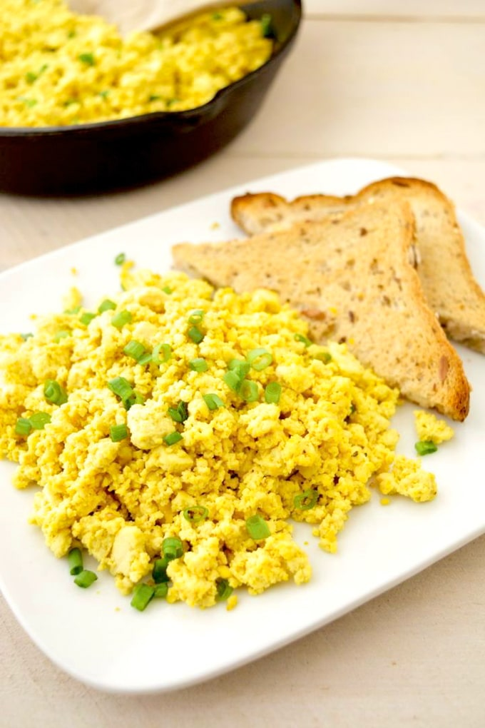 This simple vegan tofu scramble requires only 6 ingredients making it a breeze to prepare. Serve it at your next weekend breakfast or brunch for a healthier alternative to eggs! gluten-free