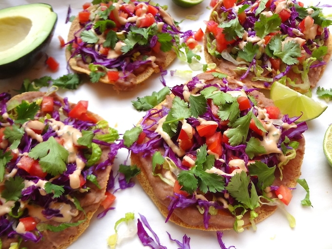 Mouth-watering, Quick 7 Layer Vegan Tostadas. So simple to prepare and ready in under 20 min... A go-to when I'm in the mood for a quick Mexican meal.