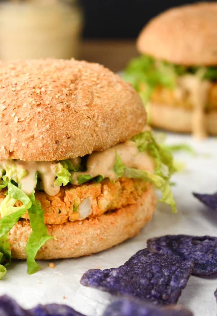 Chickpea Burgers with Spicy Cajun Sauce are vegan food obsession worthy! The chickpea patties are kid friendly. The sauce, however, may not be! But that won't stop you from slathering this spicy cajun sauce on every bite! Serve with a side of chips, or baked fries, for the perfect weeknight dinner! (gluten-free option)