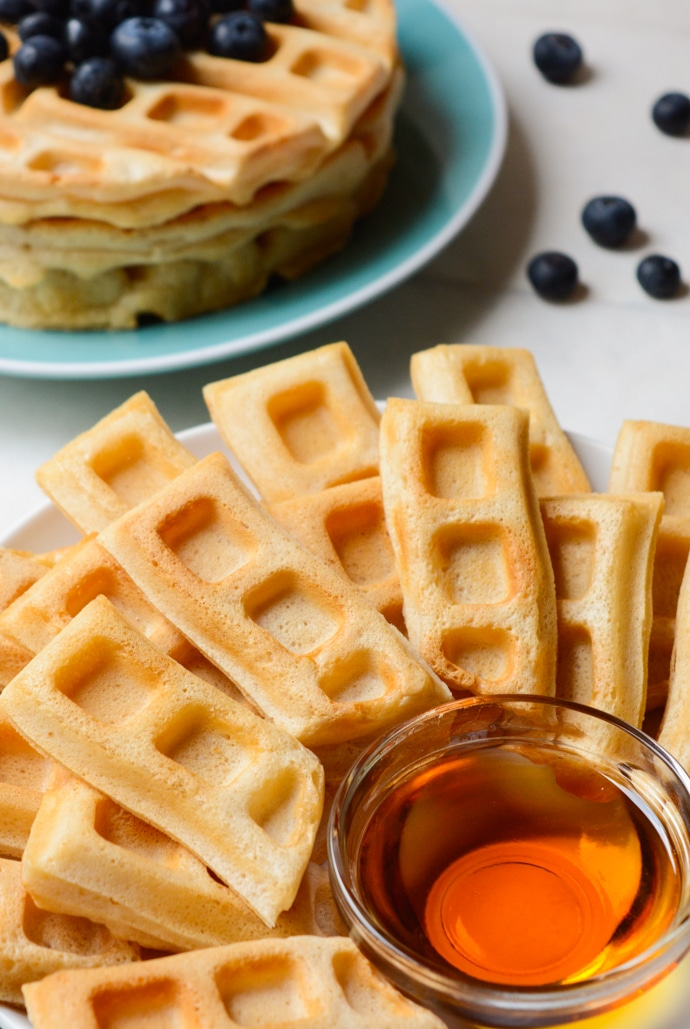 Vegan Vanilla Waffle sticks are a fun, dippable breakfast for kids and adults alike! A few special ingredients give these homemade waffle sticks an extra crispy outside while the center remains soft and fluffy. Keep the recipe classic and serve with maple syrup or go all out with a fancy fruit dip and coconut whipped cream!