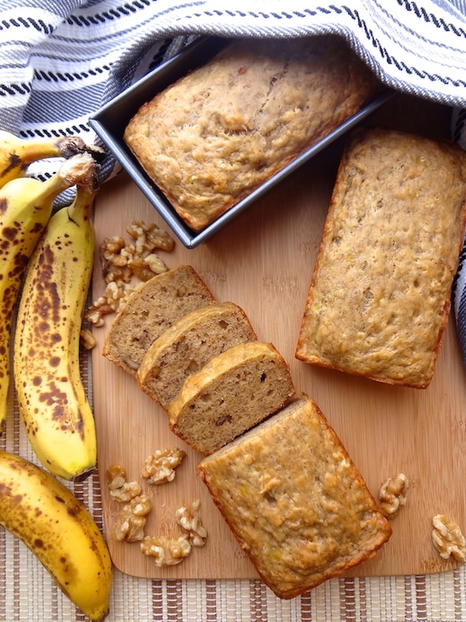 3 mini loaves of vegan banana bread. One has 3 pieces cut from it.