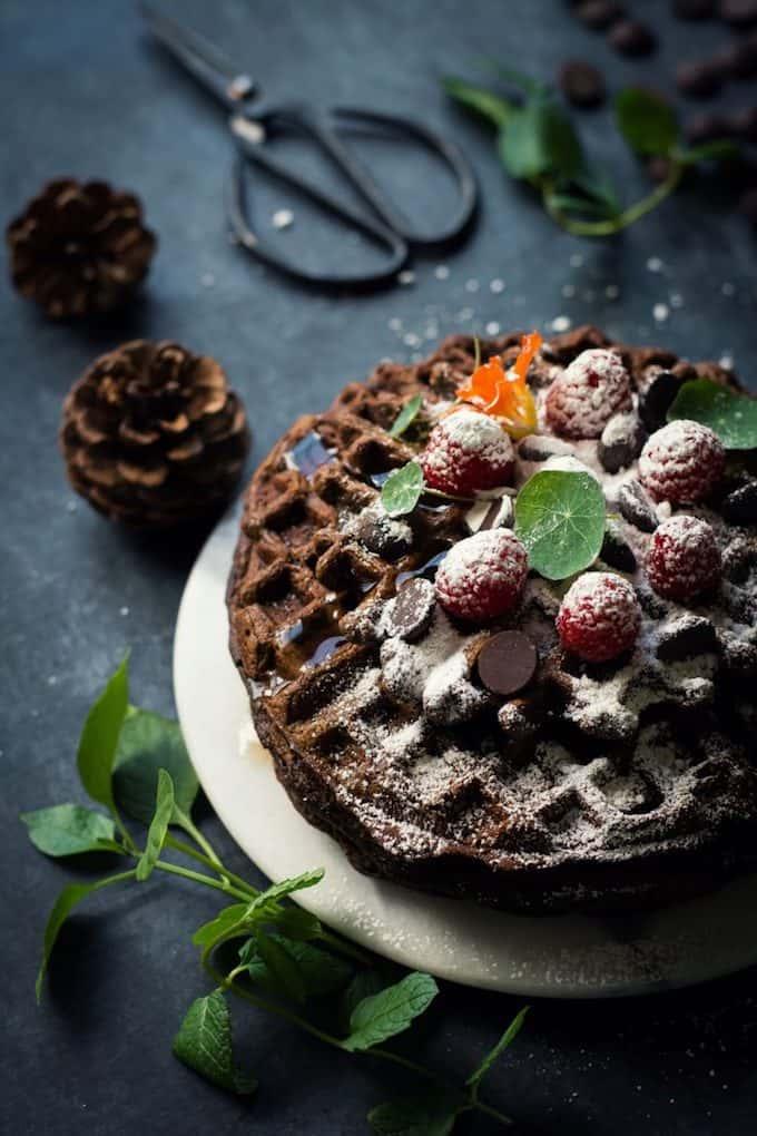 Chocolate sweet potato waffles on a white plate
