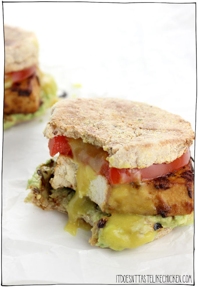 Flavored tofu, tomatoes, and avocado on an english muffin.