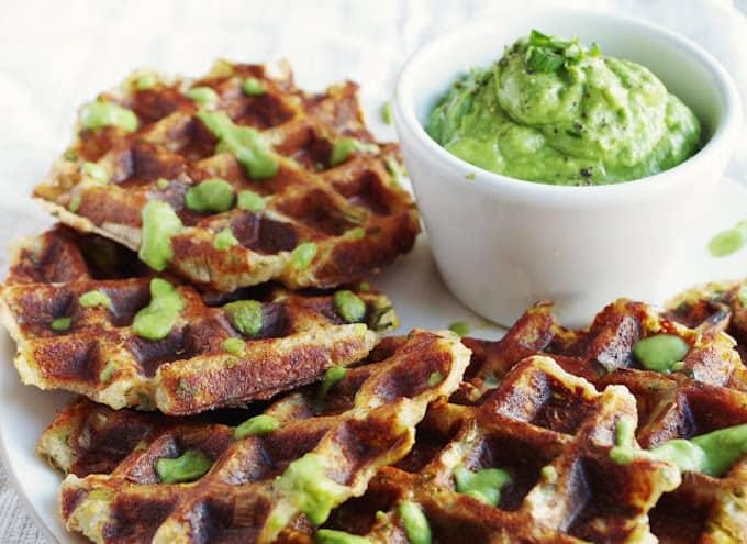 Savory potato leek waffles with side of zesty avocado sauce.