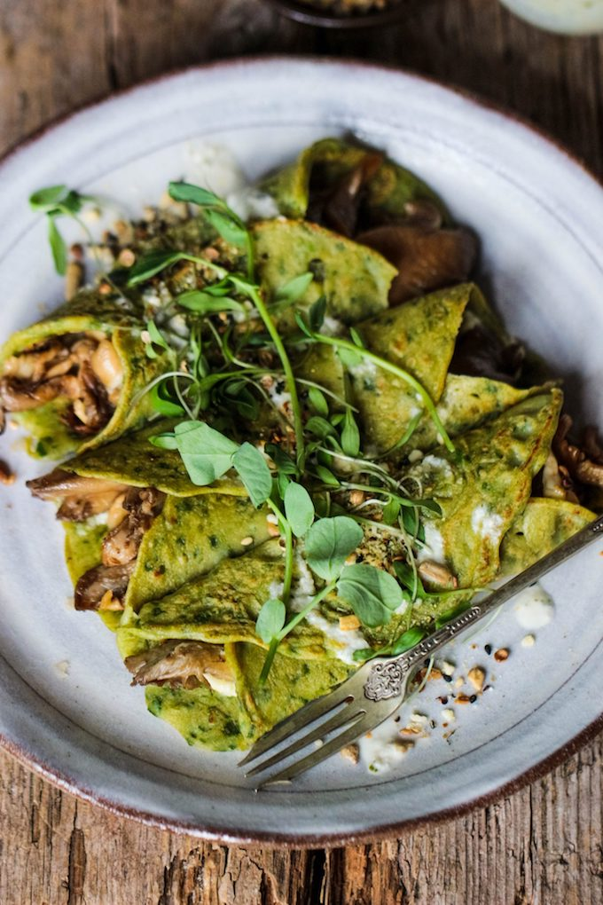spinach crepes topped with fresh herbs.
