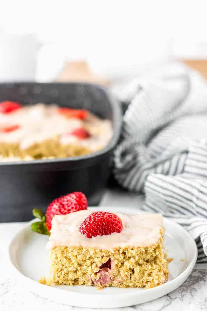 a slice of vegan strawberry breakfast cake.