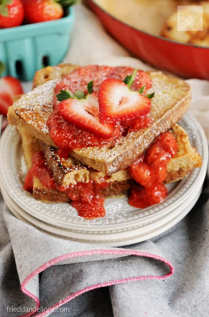 vegan vanilla french toast topped with fresh strawberries