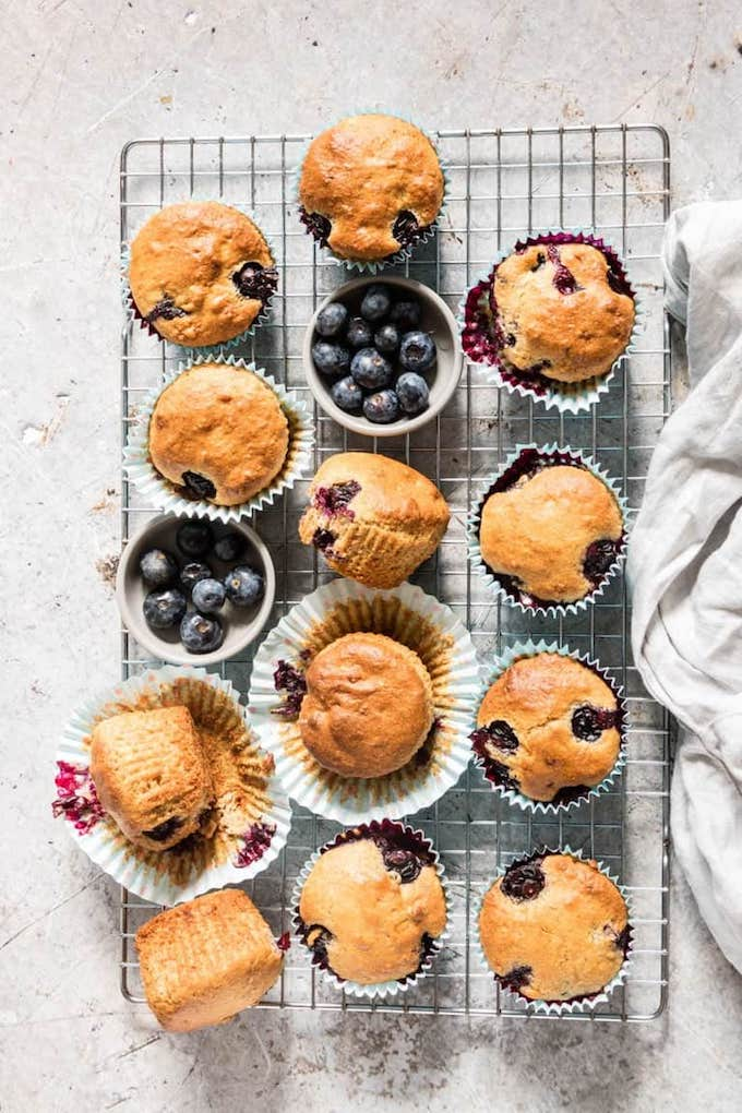 blueberry muffins on a cooling rack.
