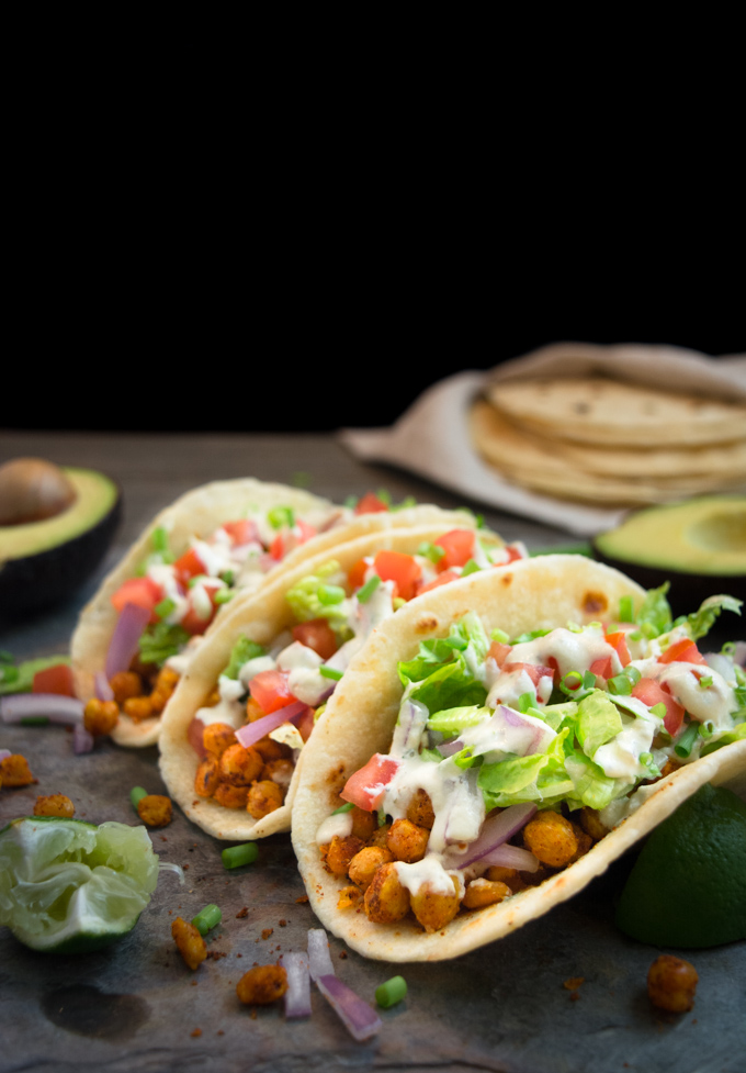 3 vegan chickpea soft tacos on homemade soft flour tortillas. They're stuffed with taco seasoned chickpeas, lettuce, onions, tomatoes and a cheesy vegan ranch dressing.