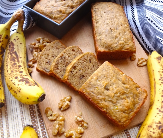 Vegan banana bread with 3 slices cut.