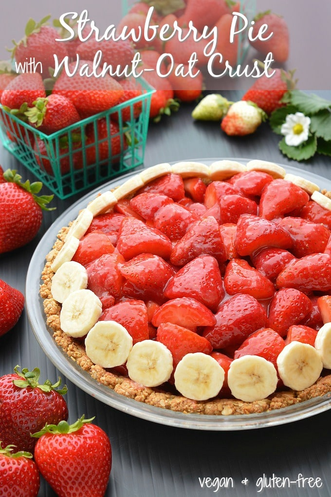 Vegan strawberry pie in a gluten-free walnut-oat crust topped with banana slices.