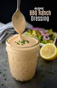 Creamy BBQ ranch dressing in a jar with a spoon.