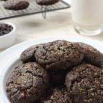 Vegan Double Chocolate Brownie Cookies are a decadent brownie crammed into a cookie then loaded with chocolate chips. Plated with a glass of plant-based milk they're a perfect egg-free, dairy-free treat.