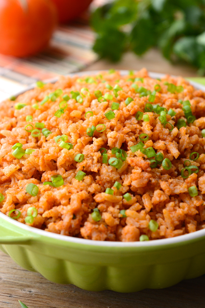 Easy spanish rice in a green serving bowl
