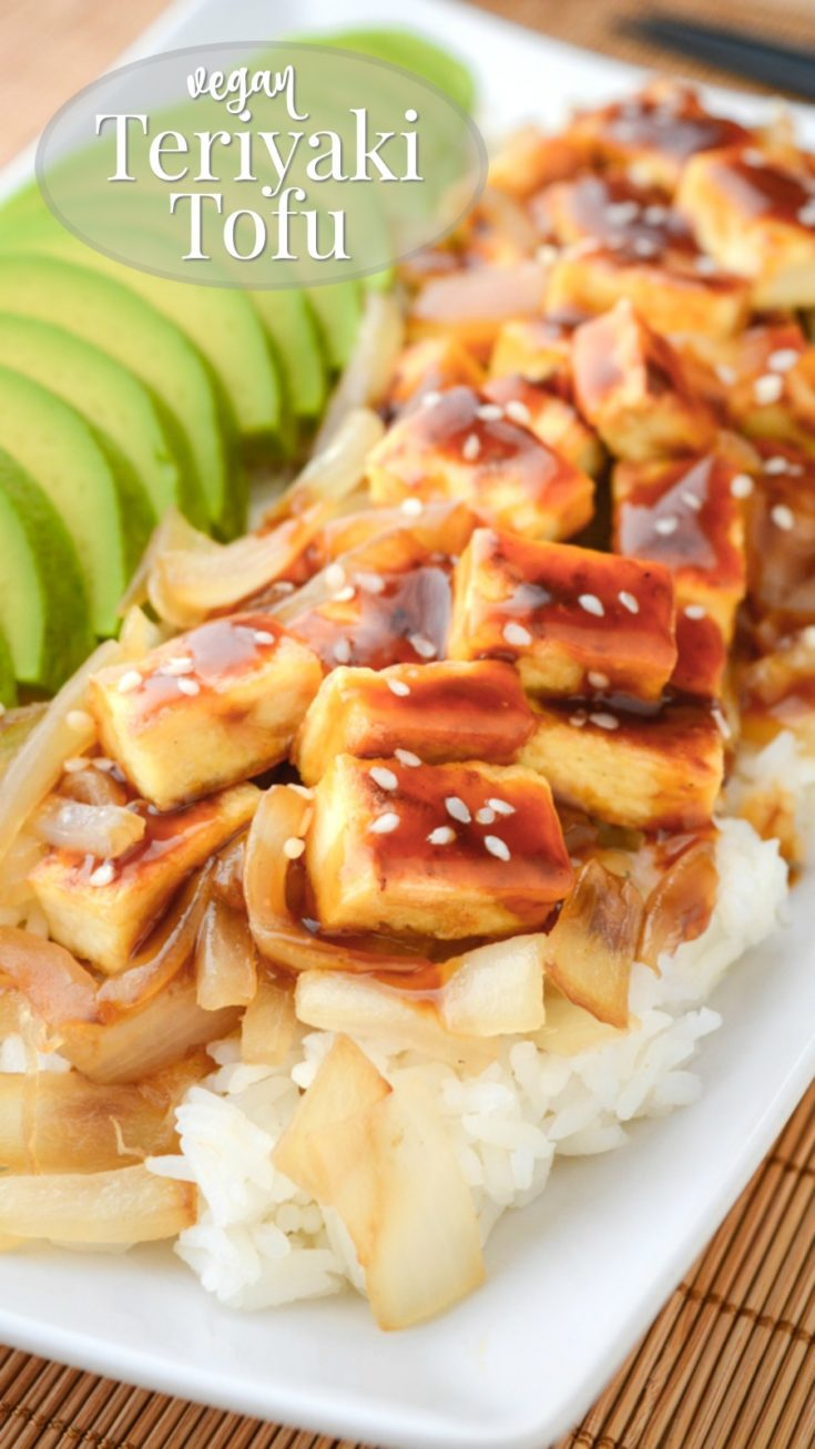 Teriyaki Tofu with Avocado is a quick and easy meal!  A bed of soft white basmati rice is piled with caramelized onions and oven baked or pan-fried crispy tofu.  Drizzle it with a sticky teriyaki sauce and top with slices of buttery-ripe avocado and sesame seeds for the perfect vegan dinner!  #vegandinner #teriyakitofu #tofurecipes #meatlessmonday #easy #veganrecipes #glutenfree