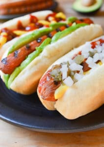 Vegan Carrot Dogs in a bun with toppings angle