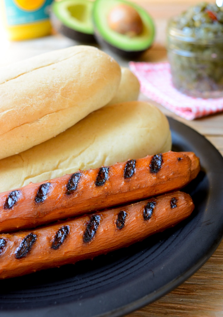 Vegan Carrot Dogs on a plate with hotdog buns.