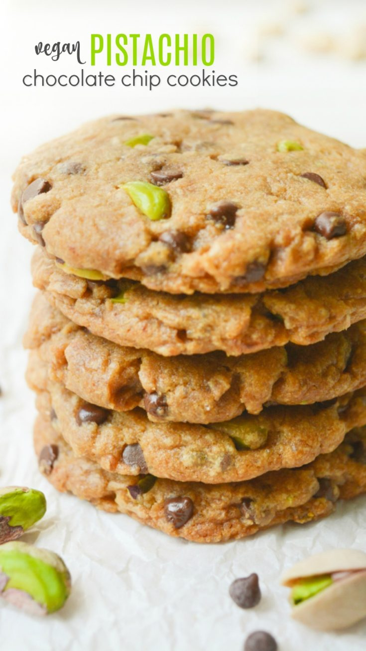 Vegan Pistachio Chocolate Chip Cookies are a great afternoon snack and perfect for lunchboxes. They're loaded with salted pistachios and mini chocolate chips for an ideal sweet and salty combo!  Bake a batch tonight and enjoy a quick evening treat! #veganrecipes #vegancookies #dairyfree #eggfreecookies #chocolatechipcookies #vegandessert #vegansnack