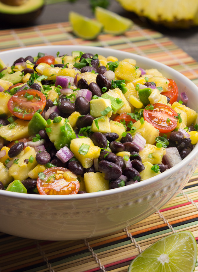 Pineapple Fiesta salad in a white bowl on a colorful mat.