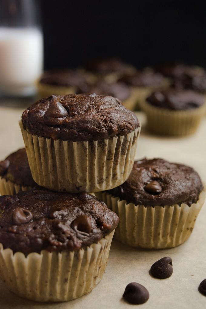 vegan chocolate banana muffins stacked.