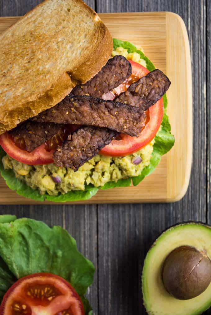 Top angle of avocado chickpea BLT sandwich.