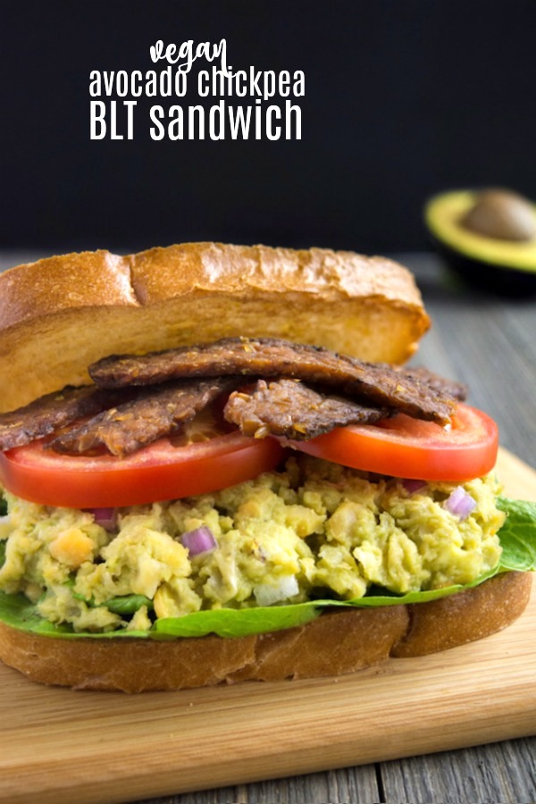 Take your ordinary vegan BLT sandwich up a few notches with this Avocado Chickpea BLT.  This irresistible sandwich is stuffed with perfectly seasoned avocado chickpea mash. It's then topped with smoky tempeh bacon, lettuce and tomato to complete this vegan BLT!  A quick and easy lunch that can be ready in minutes! #vegansandwich #avocado #chickpeasalad #veganrecipe #summer #summersandwich #vegan