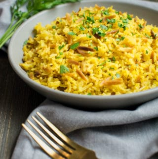 Instant-Pot rice pilaf on a gray plate with a fork.