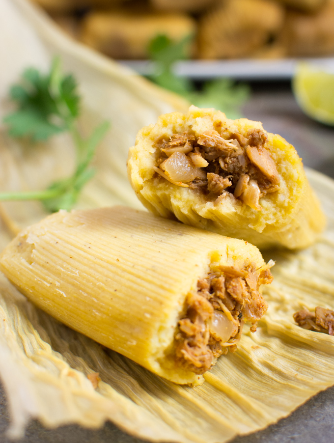 Jackfruit vegan tamale broken in half.