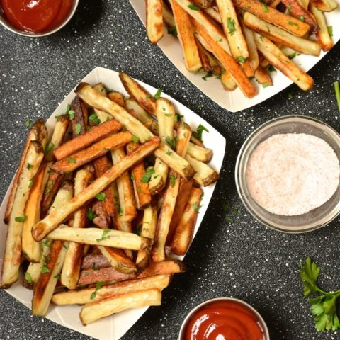 2 paper fry boats filled with oven baked fries.
