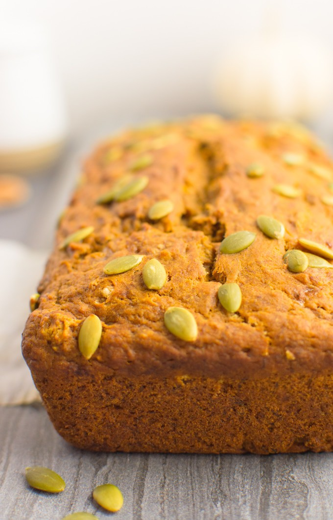 Vegan banana bread loaf topped with pumpkin seeds.