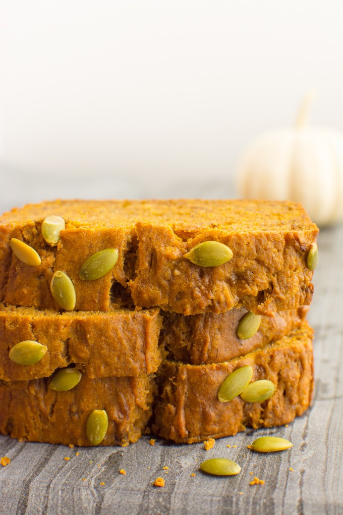 3 stacked slices of vegan pumpkin banana bread.
