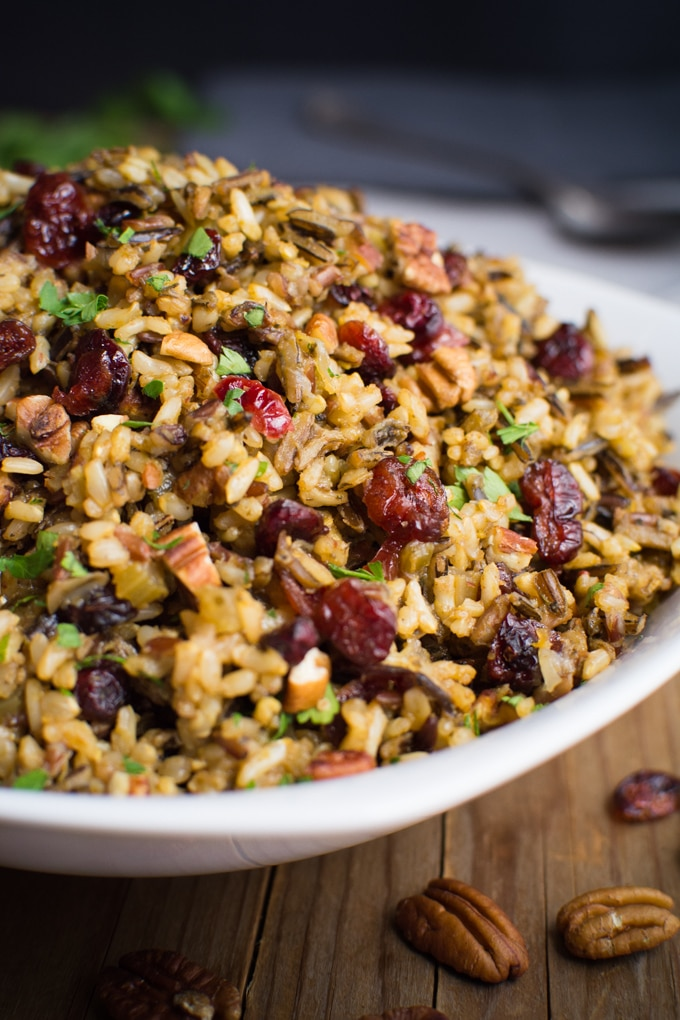Wild rice stuffing with cranberries and toasted pecans in a serving bowl.