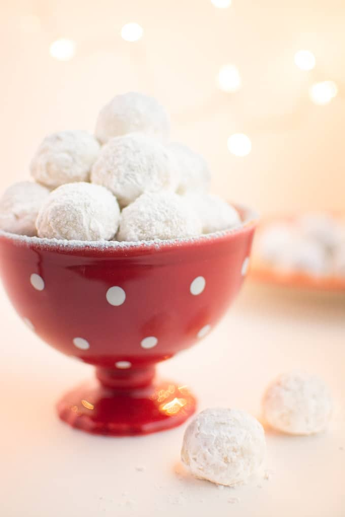 Vegan Snowball Cookies in a red holiday serving dish.