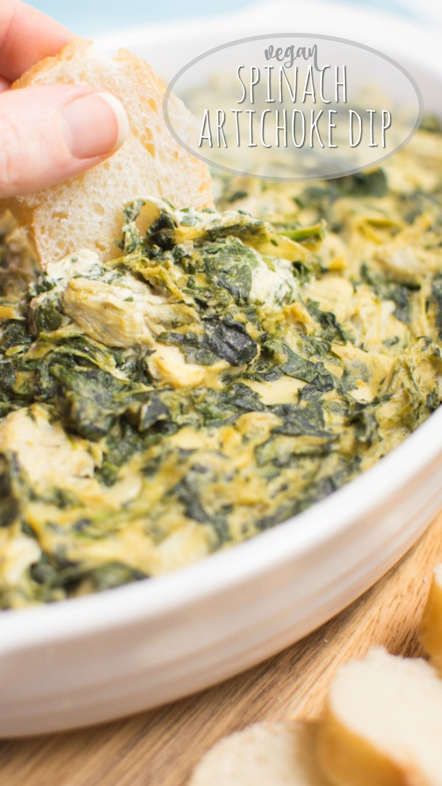 Vegan spinach artichoke dip with writing for Pinterest.
