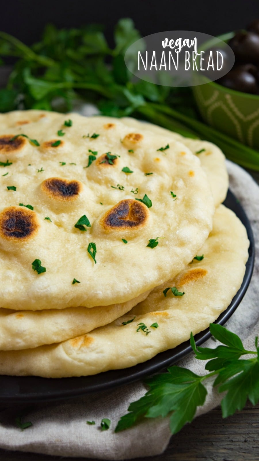Homemade vegan naan bread is better than any store bought flatbread!  This soft pliable bread is irresistible with dips, curries, soups and more! The dough easily freezes so fresh vegan naan can be enjoyed anytime! #vegannaan #naanbreads #naanrecipes #vegan #veganrecipes #veganflatbread