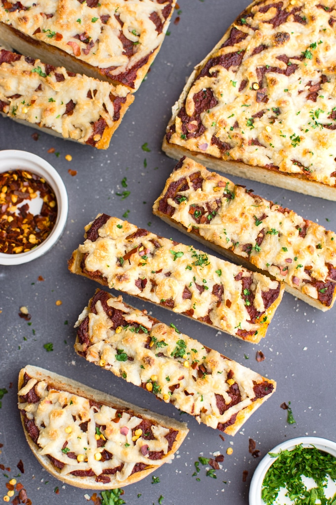 Vegan french bread pizza topped with cheese and cut into 2-inch slices.