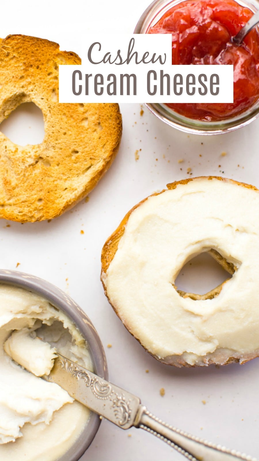 Cashew cream cheese spread on a toasted bagel with writing for Pinterest.