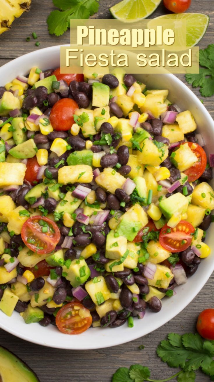 Pineapple Fiesta Salad is an easy summer salad! It's loaded with sweet pineapple chunks, juicy tomatoes, diced avocado, and protein-packed black beans, then covered in a tangy lime dressing. Serve this quick & easy cold salad as a dip, wrap or side and watch it disappear! #vegan #veganrecipe #pineapple #summer #easyrecipe #partyfood