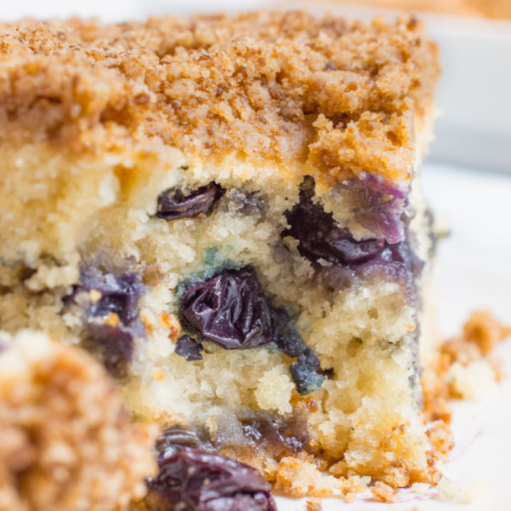 Vegan blueberry breakfast cake with bite missing.