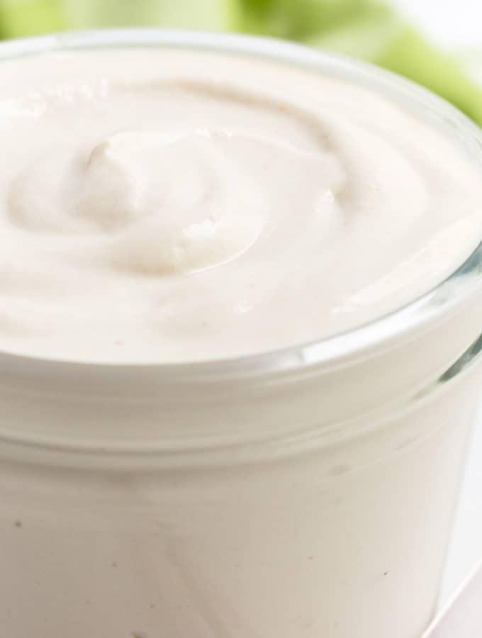 Vegan cashew mayo in a glass jar.