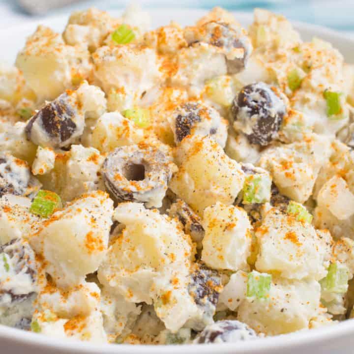 Vegan potato salad in a white bowl.