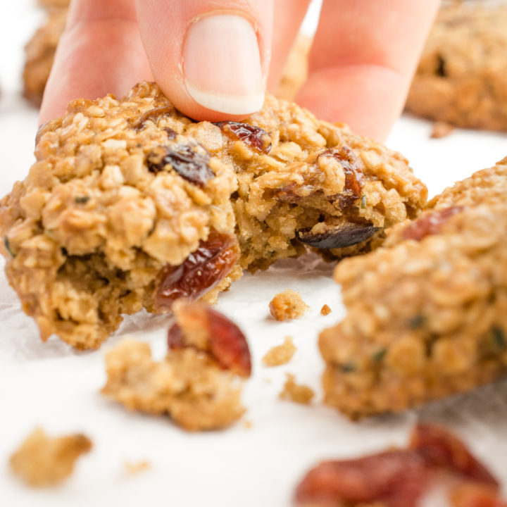 Oatmeal cranberry breakfast cookie broken in half.