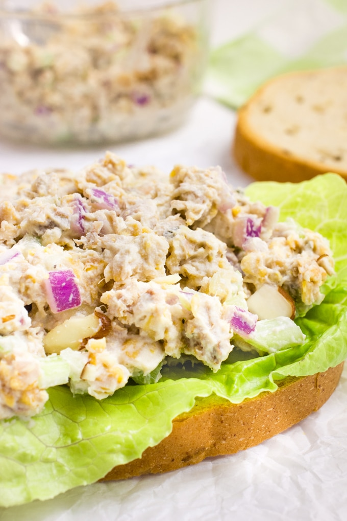 Open faced vegan sandwich topped with a chickpea, jackfruit, vegan mayo mixture..