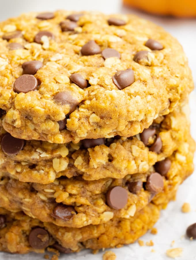 A stack of vegan pumpkin oatmeal cookies with chocolate chips.