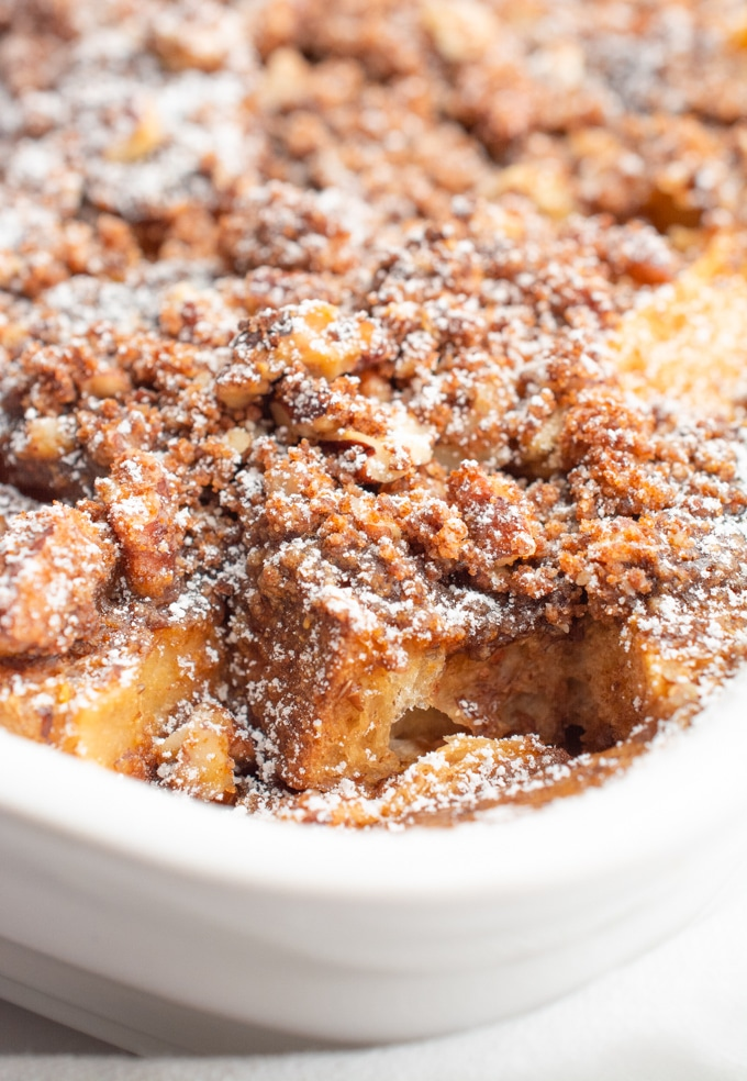 Close up of french toast casserole in a white baking dish.