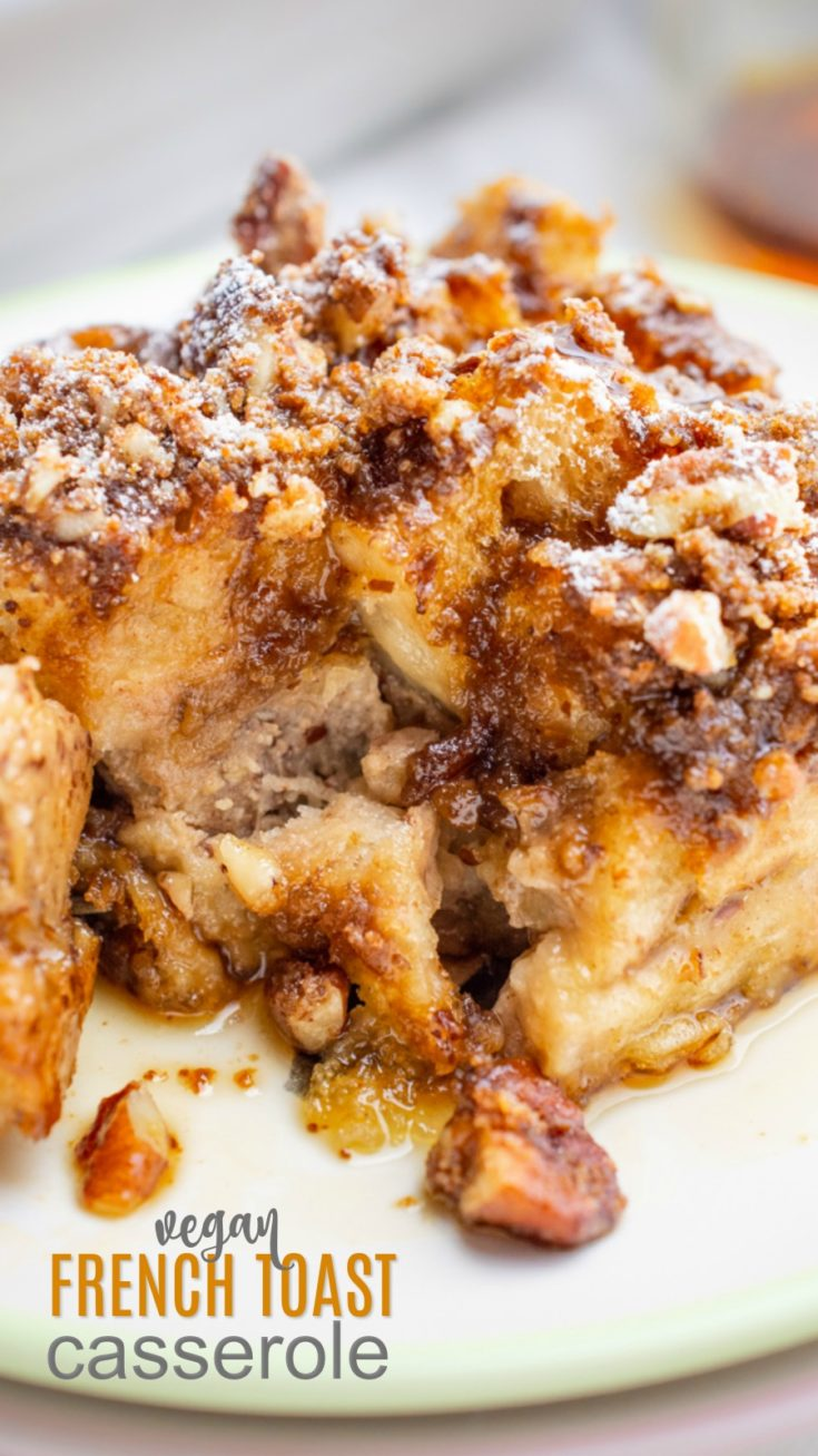Vegan french toast casserole is an easy-to-make weekend breakfast treat! Pieces of french bread are covered in a homemade vegan custard, then topped with a candied pecan crumble and baked to perfection! Enjoy this french toast casserole right away or refrigerate overnight and bake it the next morning. Holiday brunch will win over the whole family with this recipe! #veganbreakfast #veganbrunch #frenchtoast #easycasserole #holidaybreakfast