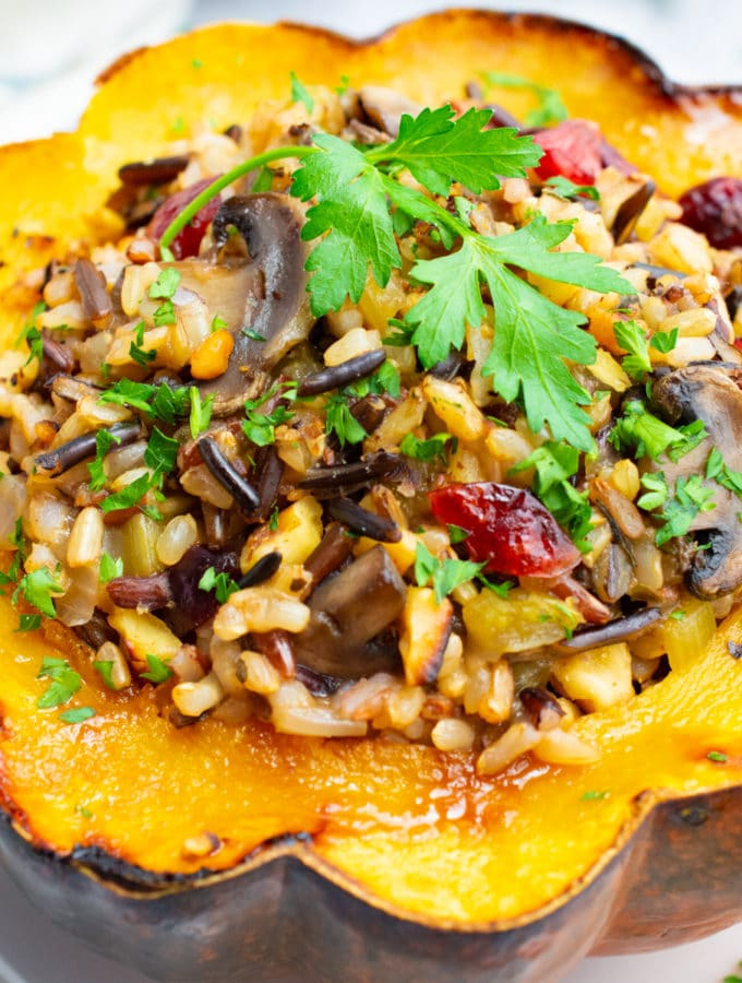 Vegetarian wild rice stuffed acorn squash with sautéed mushrooms, dried cranberries and toasted walnuts.
