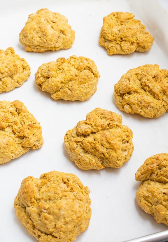 Vegan sweet potato biscuits on a baking sheet after baking.
