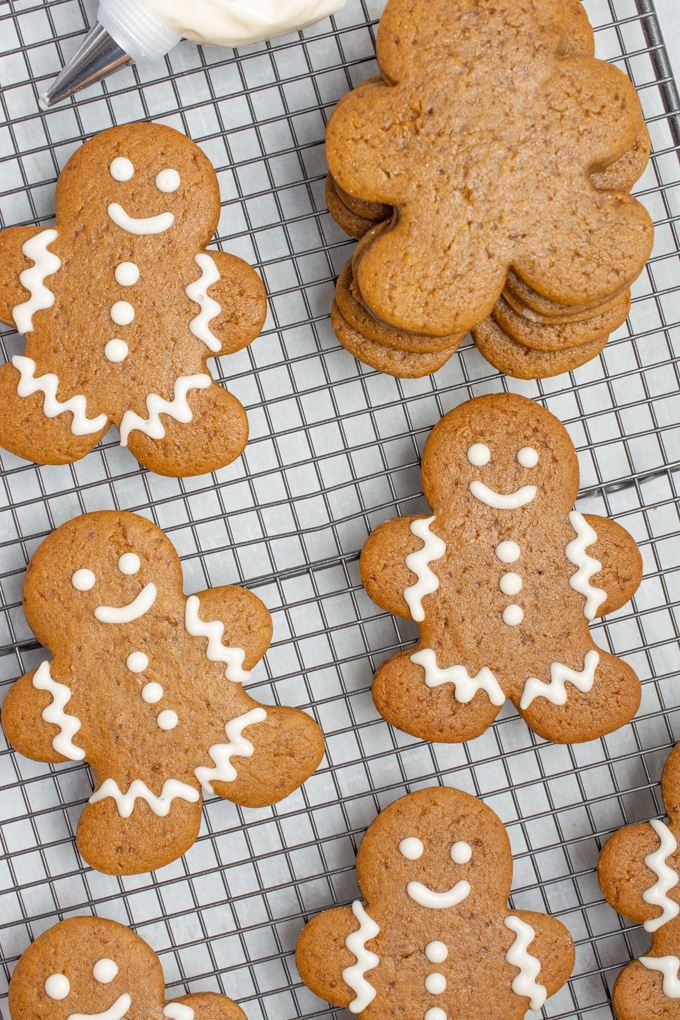 Gingerbread cookies being decorated.