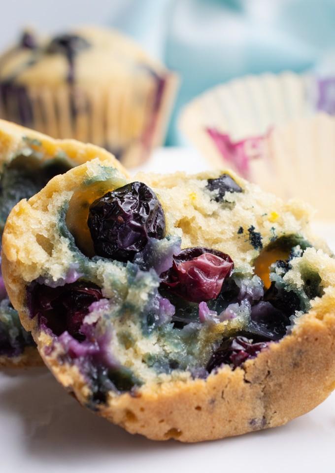 Blueberry muffin broken in half.